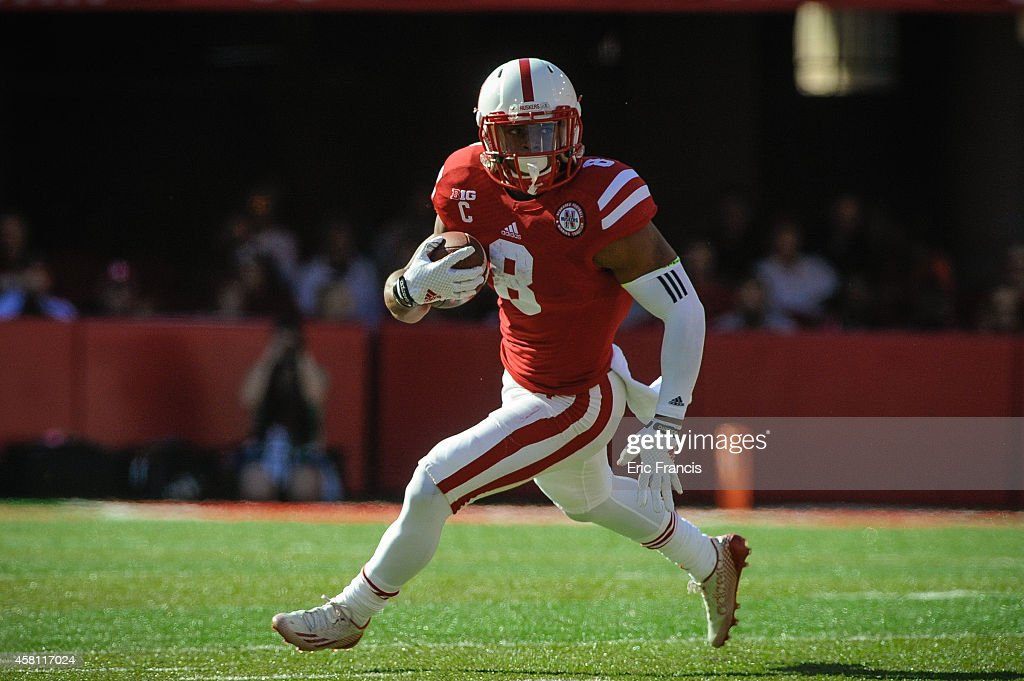 Running back <a gi-track='captionPersonalityLinkClicked' href=/galleries/search?phrase=Ameer+Abdullah&family=editorial&specificpeople=8199967 ng-click='$event.stopPropagation()'>Ameer Abdullah</a> #8 of the Nebraska Cornhuskers runs for a touchdown during the game against the Rutgers Scarlet Knights at Memorial Stadium on October 25, 2014 in Lincoln, Nebraska. Abdullah set a school record for career all-purpose yards. Nebraska defeated Rutgers 42-24.