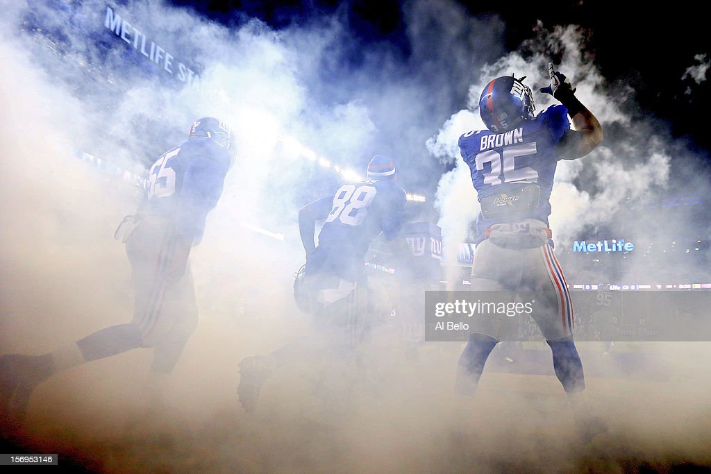Running back Andre Brown #35 of the New York Giants points to the sky as he and his teammates take the field prior to playing against the Green Bay Packers at MetLife Stadium on November 25, 2012 in East Rutherford, New Jersey.