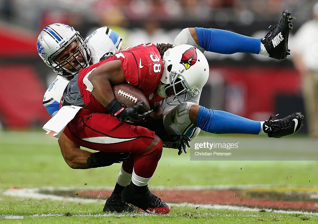 Running back <a gi-track='captionPersonalityLinkClicked' href=/galleries/search?phrase=Andre+Ellington&family=editorial&specificpeople=5519153 ng-click='$event.stopPropagation()'>Andre Ellington</a> #38 of the Arizona Cardinals is tackled by outside linebacker <a gi-track='captionPersonalityLinkClicked' href=/galleries/search?phrase=DeAndre+Levy&family=editorial&specificpeople=2251678 ng-click='$event.stopPropagation()'>DeAndre Levy</a> #54 of the Detroit Lions in the first quarter during the NFL game at the University of Phoenix Stadium on November 16, 2014 in Glendale, Arizona.