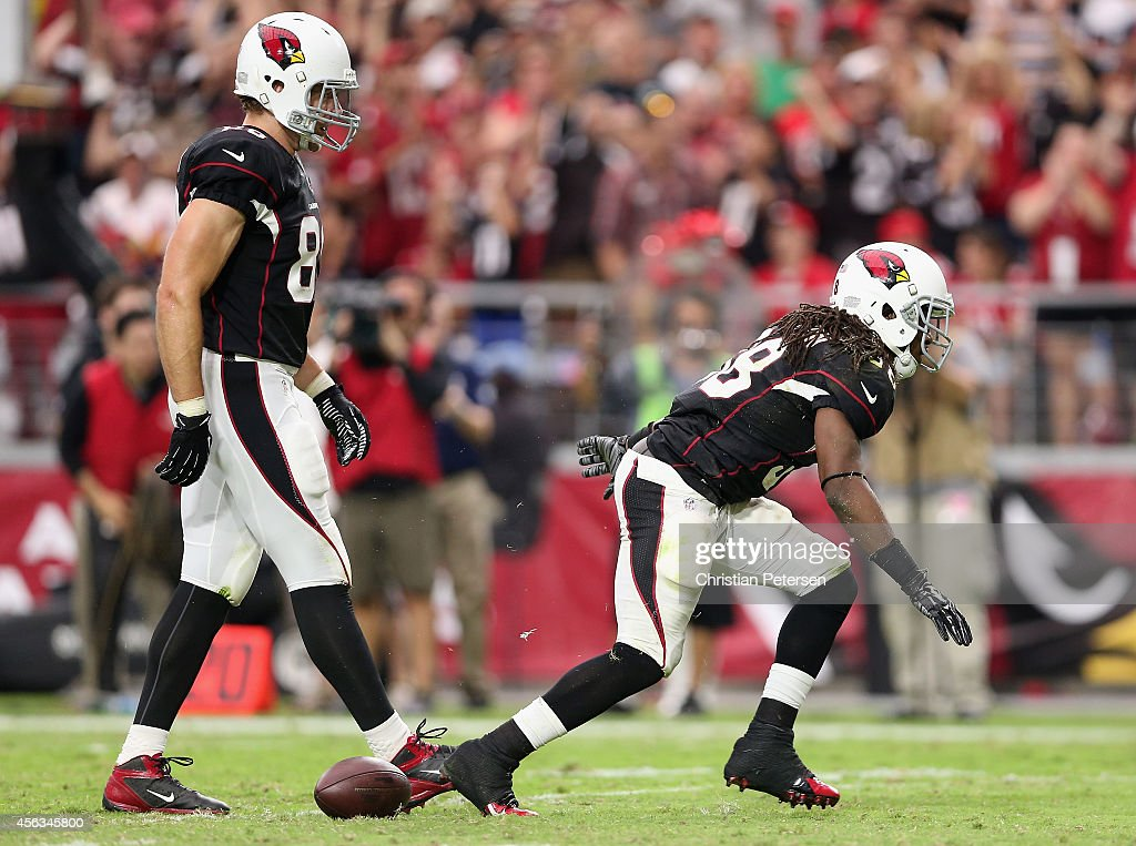 Running back <a gi-track='captionPersonalityLinkClicked' href=/galleries/search?phrase=Andre+Ellington&family=editorial&specificpeople=5519153 ng-click='$event.stopPropagation()'>Andre Ellington</a> #38 of the Arizona Cardinals reacts after a first down rush against the San Francisco 49ers during the NFL game at the University of Phoenix Stadium on September 21, 2014 in Glendale, Arizona. The Cardinals defeated the 49ers 23-14.