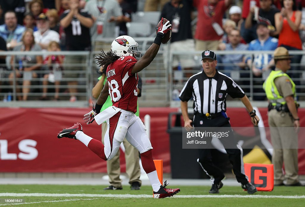 Running back Andre Ellington #38 of the Arizona Cardinals scores a touchdown against the Detroit Lions in the first half at University of Phoenix Stadium on September 15, 2013 in Glendale, Arizona. The Cardinals defeated the Lions 25-21.