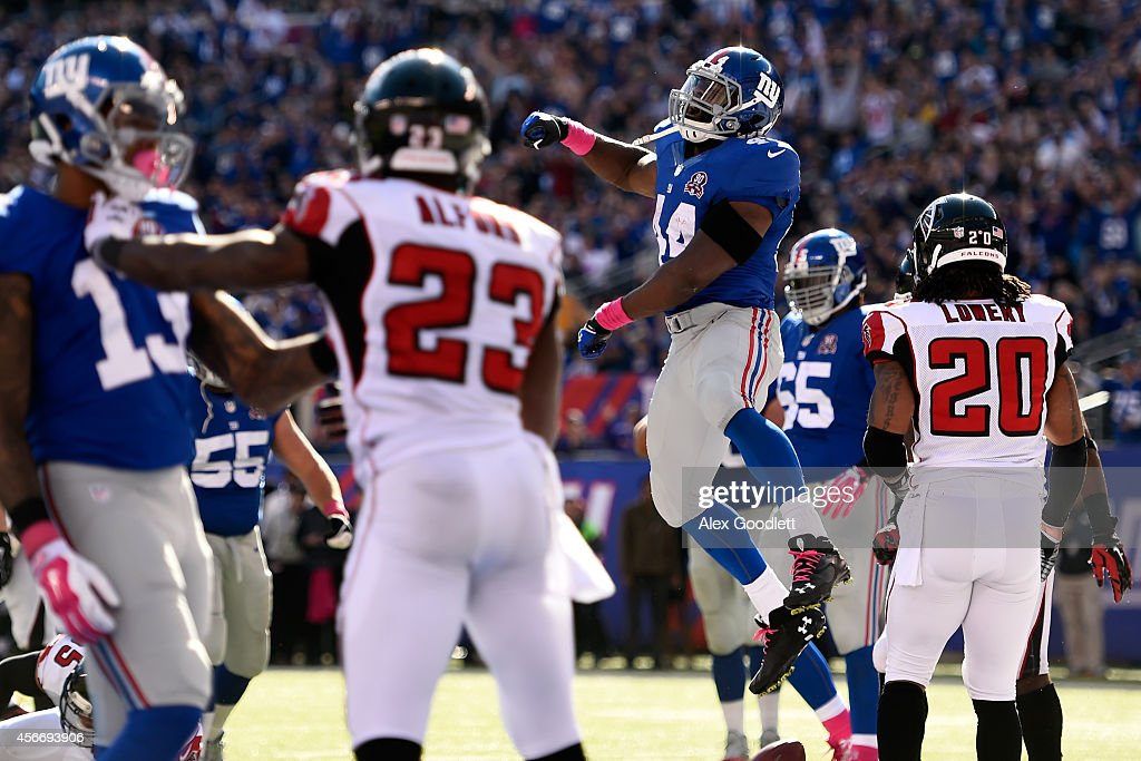 Running back Andre Williams of the New York Giants celebrates after scoring a three yard touchdown in the third quarter against the Atlanta Falcons...