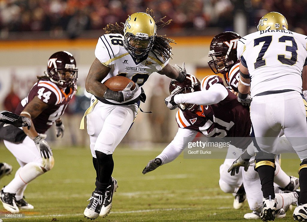 Running back <a gi-track='captionPersonalityLinkClicked' href=/galleries/search?phrase=Anthony+Allen&family=editorial&specificpeople=542876 ng-click='$event.stopPropagation()'>Anthony Allen</a> #18 of the Georgia Tech Yellow Jackets runs with the ball as linebacker Bruce Taylor #51 of the Virginia Tech Hokies chases at Lane Stadium on November 4, 2010 in Blacksburg, Virginia.