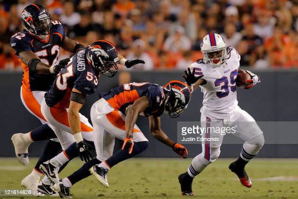 running back Anthony Elzy of the Buffalo Bills looks stiffarms cornerback Perrish Cox of the Denver Broncos as linebacker Mike Mohamed and Jason...