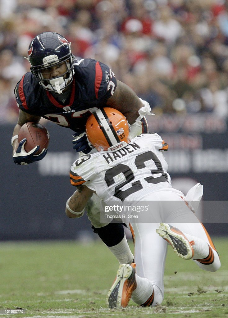 Running back <a gi-track='captionPersonalityLinkClicked' href=/galleries/search?phrase=Arian+Foster&family=editorial&specificpeople=2128663 ng-click='$event.stopPropagation()'>Arian Foster</a> #23 of the Houston Texans is tackled by defensive back <a gi-track='captionPersonalityLinkClicked' href=/galleries/search?phrase=Joe+Haden&family=editorial&specificpeople=4489430 ng-click='$event.stopPropagation()'>Joe Haden</a> #23 of the Cleveland Browns on November 6, 2011 at Reliant Stadium in Houston, Texas.