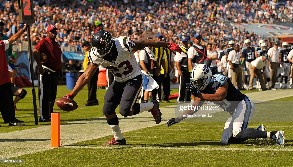Running back <a gi-track='captionPersonalityLinkClicked' href=/galleries/search?phrase=Arian+Foster&family=editorial&specificpeople=2128663 ng-click='$event.stopPropagation()'>Arian Foster</a> #23 of the Houston Texans scores a touchdown against <a gi-track='captionPersonalityLinkClicked' href=/galleries/search?phrase=Michael+Griffin+-+American+Football+Player&family=editorial&specificpeople=11519419 ng-click='$event.stopPropagation()'>Michael Griffin</a> #33 of the Tennessee Titans at LP Field on October 26, 2014 in Nashville, Tennessee.