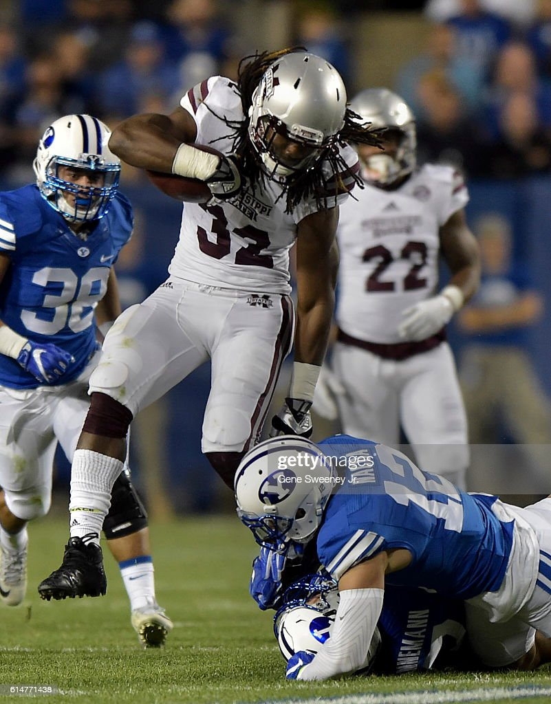 Running back Ashton Shumpert #32 of the Mississippi State Bulldogs avoids defenders Mitch Hannemann #7 and Kai Nacua #12 of the Brigham Young Cougars in the second quarter at LaVell Edwards Stadium on October 14, 2016 in Provo Utah.