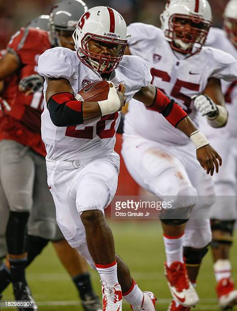 Running back Barry Sanders of the Stanford Cardinal rushes against the Washington State Cougars on September 28 2013 at CenturyLink Field in Seattle...