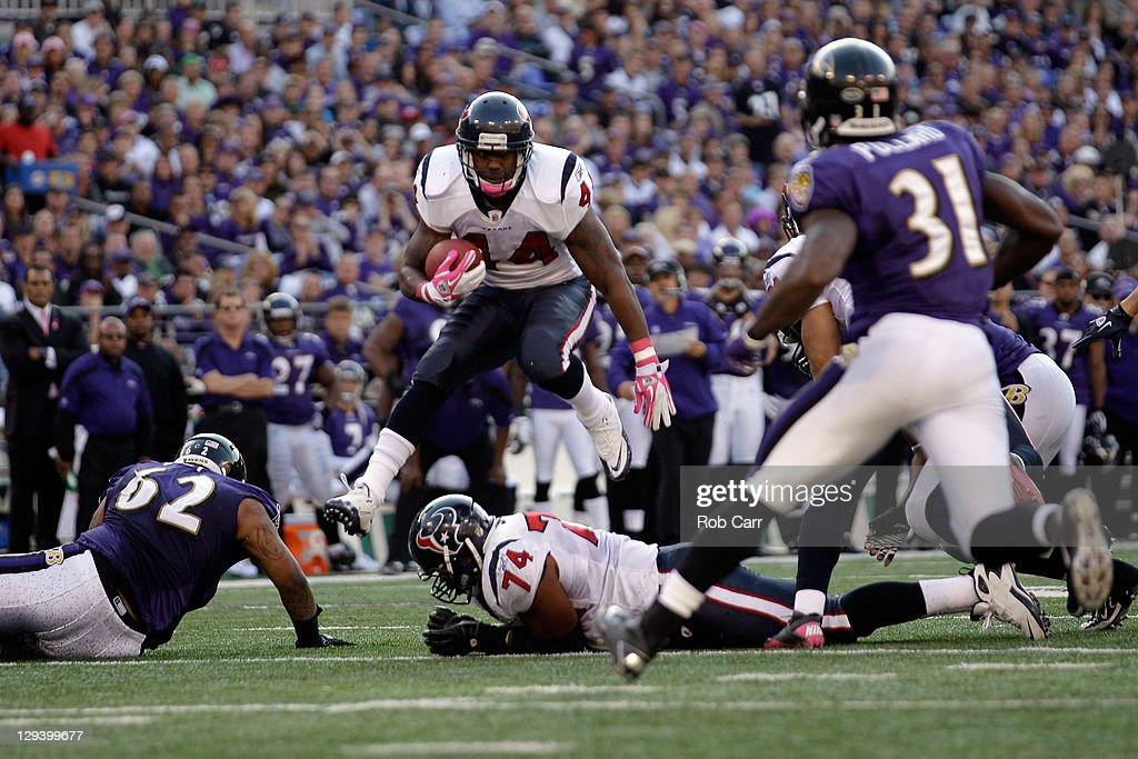 Running back <a gi-track='captionPersonalityLinkClicked' href=/galleries/search?phrase=Ben+Tate&family=editorial&specificpeople=4091148 ng-click='$event.stopPropagation()'>Ben Tate</a> #44 of the Houston Texans carries the ball against the Baltimore Ravens at M&T Bank Stadium on October 16, 2011 in Baltimore, Maryland.