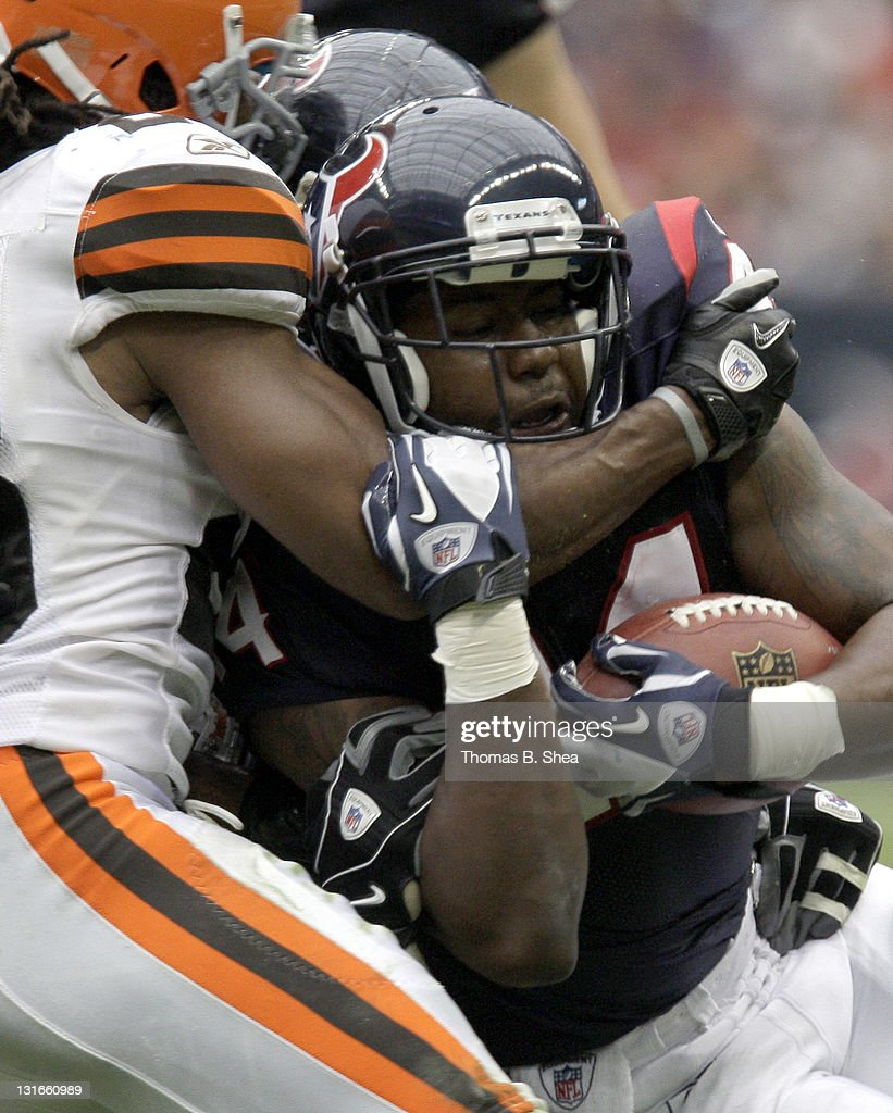 Running back <a gi-track='captionPersonalityLinkClicked' href=/galleries/search?phrase=Ben+Tate&family=editorial&specificpeople=4091148 ng-click='$event.stopPropagation()'>Ben Tate</a> #44 of the Houston Texans is tackled by defensive back Usama Young #28 of the Cleveland Browns on November 6, 2011 at Reliant Stadium in Houston, Texas.