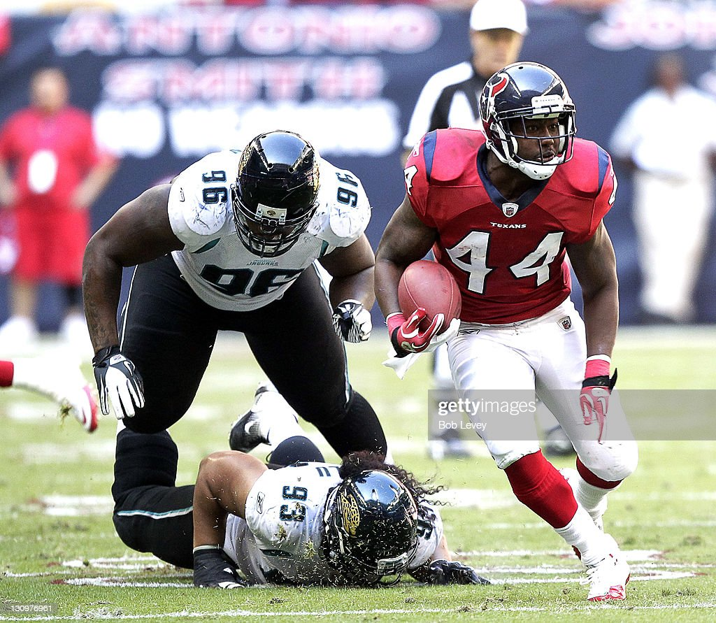 Running back <a gi-track='captionPersonalityLinkClicked' href=/galleries/search?phrase=Ben+Tate&family=editorial&specificpeople=4091148 ng-click='$event.stopPropagation()'>Ben Tate</a> #44 of the Houston Texans rushes past defensive tackle <a gi-track='captionPersonalityLinkClicked' href=/galleries/search?phrase=Tyson+Alualu&family=editorial&specificpeople=4511336 ng-click='$event.stopPropagation()'>Tyson Alualu</a> #93 and <a gi-track='captionPersonalityLinkClicked' href=/galleries/search?phrase=Terrance+Knighton&family=editorial&specificpeople=5732536 ng-click='$event.stopPropagation()'>Terrance Knighton</a> #96 of the Jacksonville Jaguars at Reliant Stadium on October 30, 2011 in Houston, Texas.