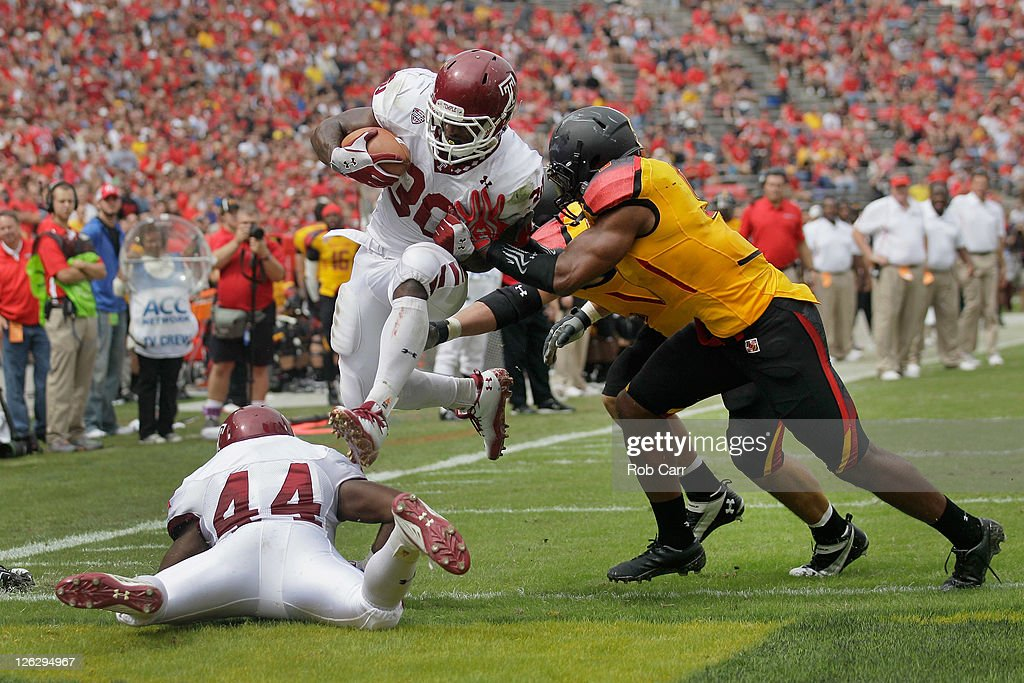 Running back Bernard Pierce jumps into the endzone past the Maryland Terrapins defense for a first quarter touchdown at Byrd Stadium on September 24...