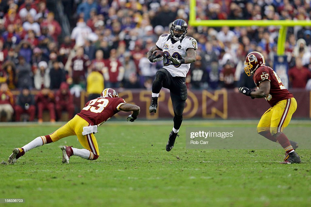 Running back Bernard Pierce #30 of the Baltimore Ravens carries the ball as cornerback DeAngelo Hall #23 and inside linebacker <a gi-track='captionPersonalityLinkClicked' href=/galleries/search?phrase=London+Fletcher&family=editorial&specificpeople=223941 ng-click='$event.stopPropagation()'>London Fletcher</a> #59 of the Washington Redskins move in to tackle him at FedExField on December 9, 2012 in Landover, Maryland.