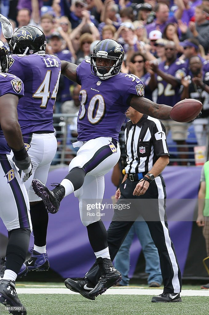 Running back Bernard Pierce of the Baltimore Ravens celebrates with Vonta Leach after rushing for a second half touchdown against the Houston Texans...
