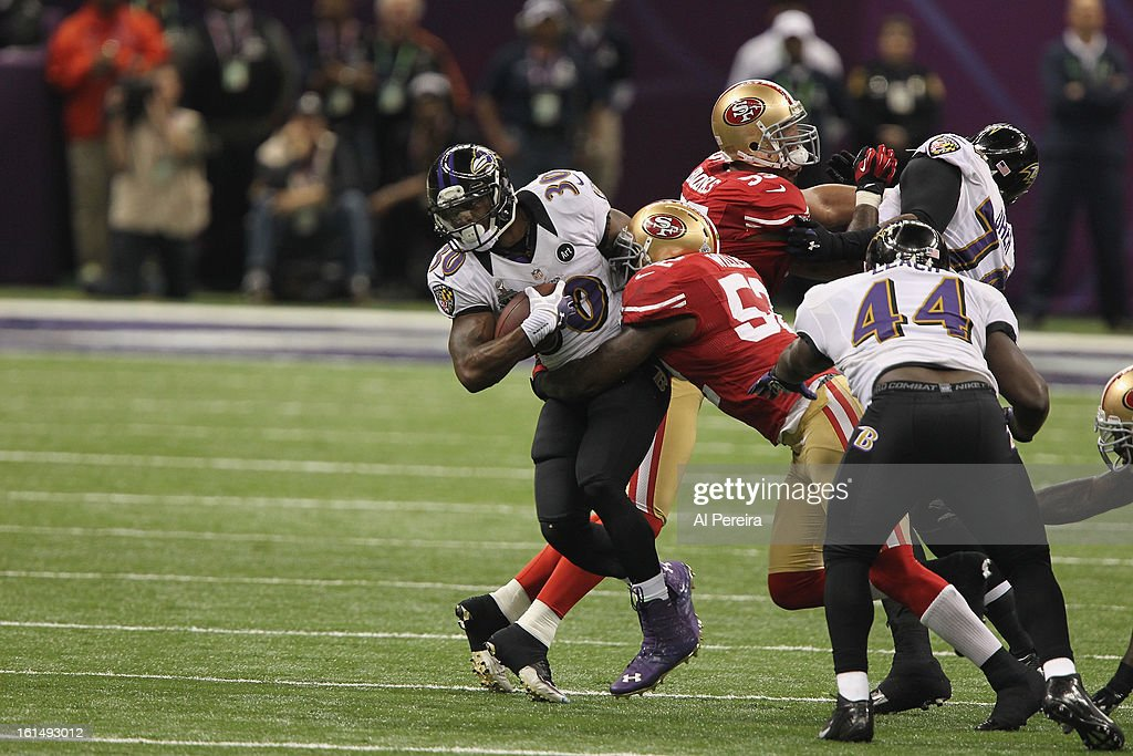 Running Back Bernard Pierce #30 of the Baltimore Ravens has a long gain against the San Francisco 49ers during Super Bowl XLVII at Mercedes-Benz Superdome on February 3, 2013 in New Orleans, Louisiana.