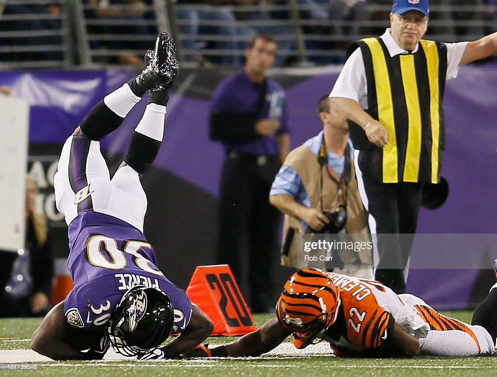 Running back Bernard Pierce #30 of the Baltimore Ravens is tackled by cornerback <a gi-track='captionPersonalityLinkClicked' href=/galleries/search?phrase=Nate+Clements&family=editorial&specificpeople=226908 ng-click='$event.stopPropagation()'>Nate Clements</a> #22 of the Cincinnati Bengals during the second half at M&T Bank Stadium on September 10, 2012 in Baltimore, Maryland.