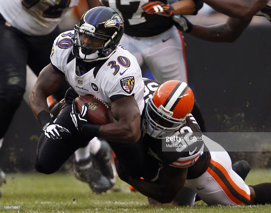Running back Bernard Pierce #30 of the Baltimore Ravens is tackled by linebacker <a gi-track='captionPersonalityLinkClicked' href=/galleries/search?phrase=D%27Qwell+Jackson&family=editorial&specificpeople=648560 ng-click='$event.stopPropagation()'>D'Qwell Jackson</a> #52 of the Cleveland Browns at Cleveland Browns Stadium on November 4, 2012 in Cleveland, Ohio.