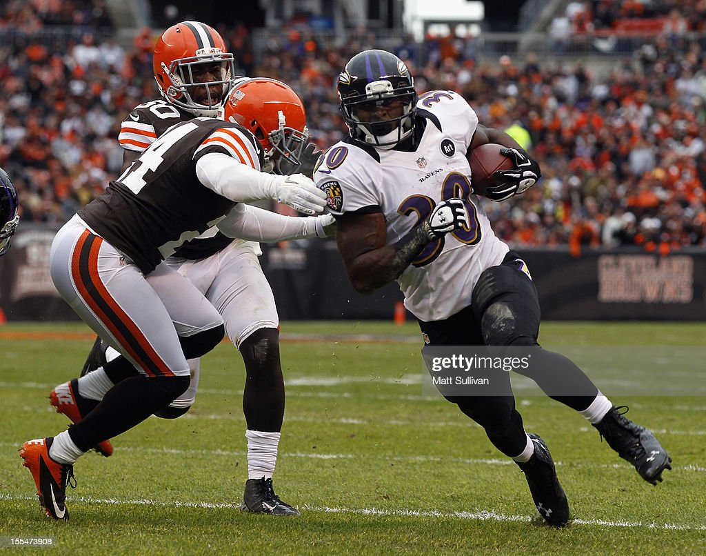 Running back Bernard Pierce #30 of the Baltimore Ravens runs the ball by linebacker James-Michael Johnson #50 and defensive back <a gi-track='captionPersonalityLinkClicked' href=/galleries/search?phrase=Sheldon+Brown&family=editorial&specificpeople=215302 ng-click='$event.stopPropagation()'>Sheldon Brown</a> #24 of the Cleveland Browns at Cleveland Browns Stadium on November 4, 2012 in Cleveland, Ohio.