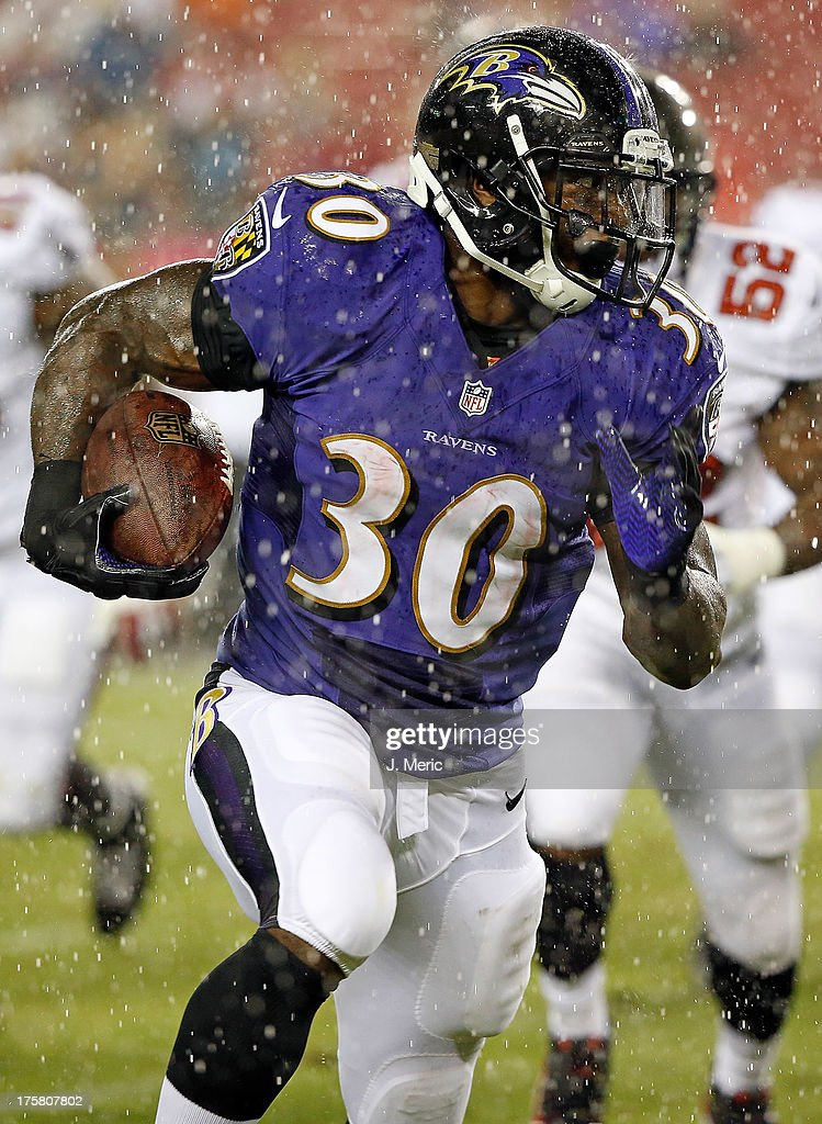 Running back <a gi-track='captionPersonalityLinkClicked' href=/galleries/search?phrase=Bernard+Pierce&family=editorial&specificpeople=6315576 ng-click='$event.stopPropagation()'>Bernard Pierce</a> #30 of the Baltimore Ravens rushes for a second quarter touchdown in the rain against the Tampa Bay Buccaneers during a preseason game at Raymond James Stadium on August 8, 2013 in Tampa, Florida.