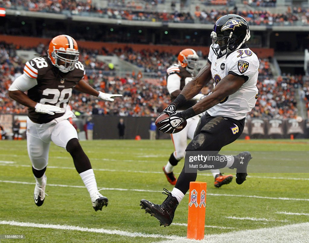 Running back Bernard Pierce #30 of the Baltimore Ravens scores a touchdown in front of defensive back <a gi-track='captionPersonalityLinkClicked' href=/galleries/search?phrase=Usama+Young&family=editorial&specificpeople=4401869 ng-click='$event.stopPropagation()'>Usama Young</a> #28 of the Cleveland Browns at Cleveland Browns Stadium on November 4, 2012 in Cleveland, Ohio.
