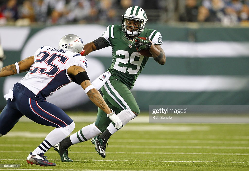 Running back Bilal Powell #29 of the New York Jets attempts to get past Patrick Chung #25 of the New England Patriots in a game at MetLife Stadium on November 22, 2012 in East Rutherford, New Jersey. The Patriots defeated the Jets 49-19.