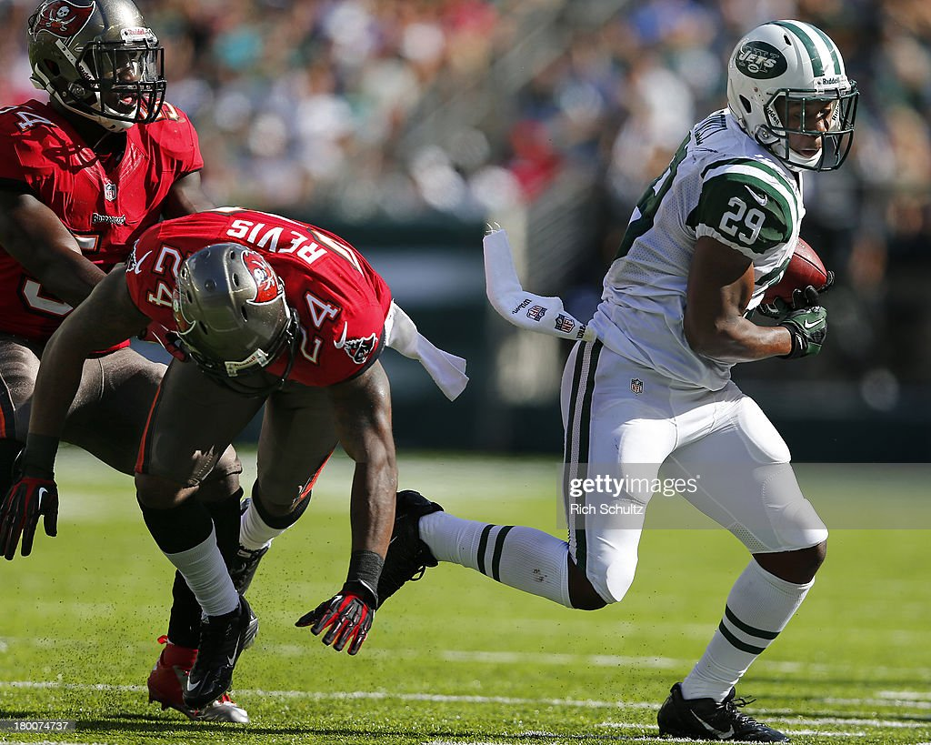 Running back <a gi-track='captionPersonalityLinkClicked' href=/galleries/search?phrase=Bilal+Powell&family=editorial&specificpeople=4671561 ng-click='$event.stopPropagation()'>Bilal Powell</a> #29 of the New York Jets gets past cornerback <a gi-track='captionPersonalityLinkClicked' href=/galleries/search?phrase=Darrelle+Revis&family=editorial&specificpeople=2198124 ng-click='$event.stopPropagation()'>Darrelle Revis</a> #24 and linebacker Lavonte David #54 of the Tampa Bay Buccaneers during the fourth quarter of a game at MetLife Stadium on September 8, 2013 in East Rutherford, New Jersey. The Jets defeated the Bucs 18-17.