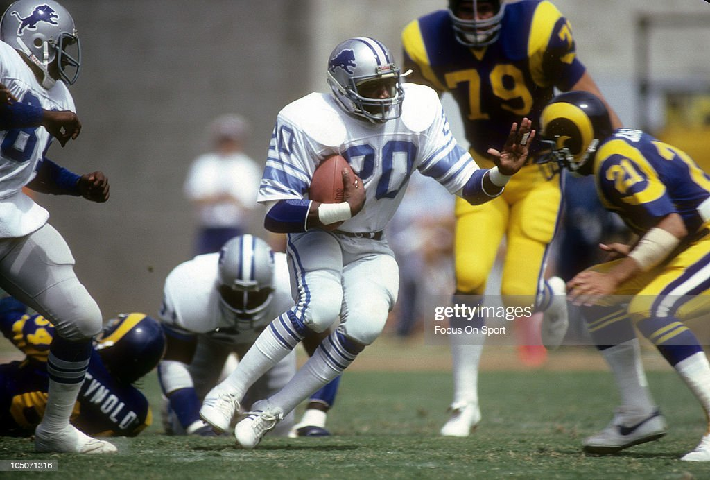Running Back <a gi-track='captionPersonalityLinkClicked' href=/galleries/search?phrase=Billy+Sims&family=editorial&specificpeople=541482 ng-click='$event.stopPropagation()'>Billy Sims</a> #20 of the Detroit Lions carries the ball against the Los Angeles Rams during an NFL football game at Anaheim Stadium September 7, 1980 in Anaheim, California. Sims played for the Lions from 1980-84.
