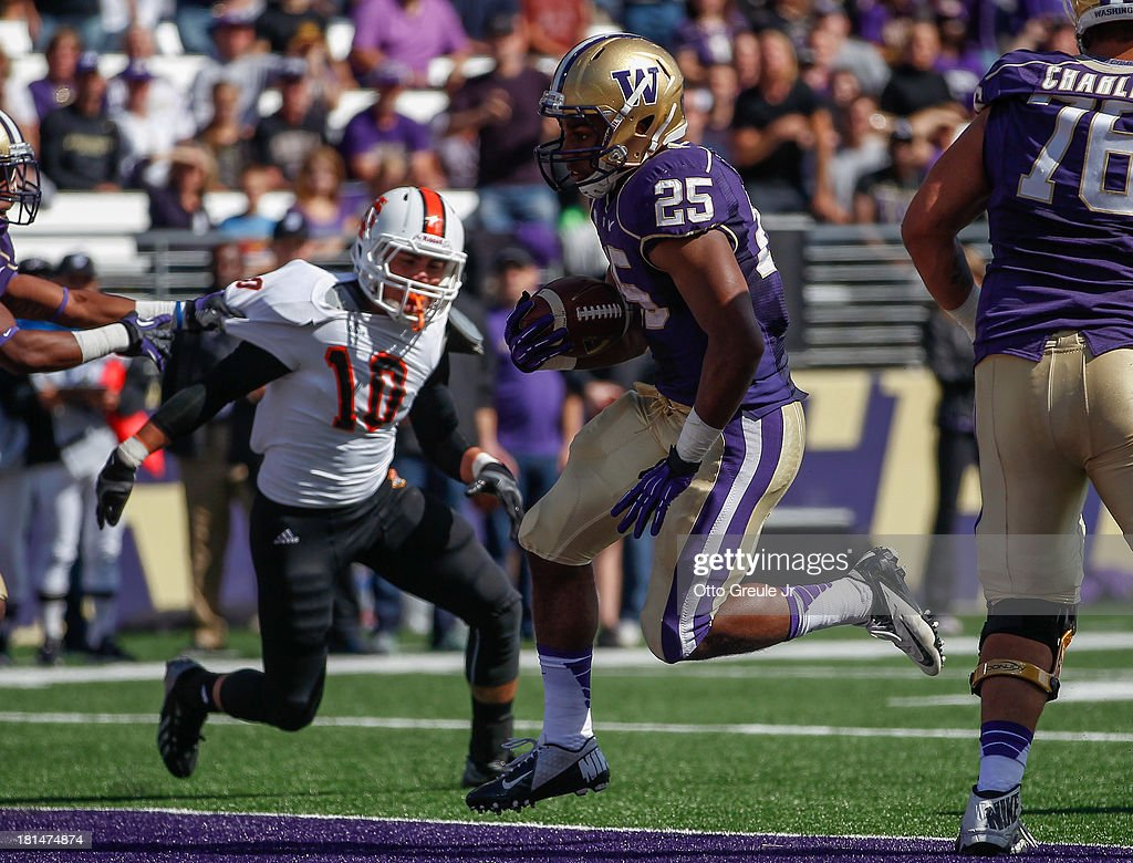 Running back Bishop Sankey #25 of the Washington Huskies rushes for a touchdown in the first quarter against the Idaho State Bengals on September 21, 2013 at Husky Stadium in Seattle, Washington. The Huskies the Bengals 56-0.