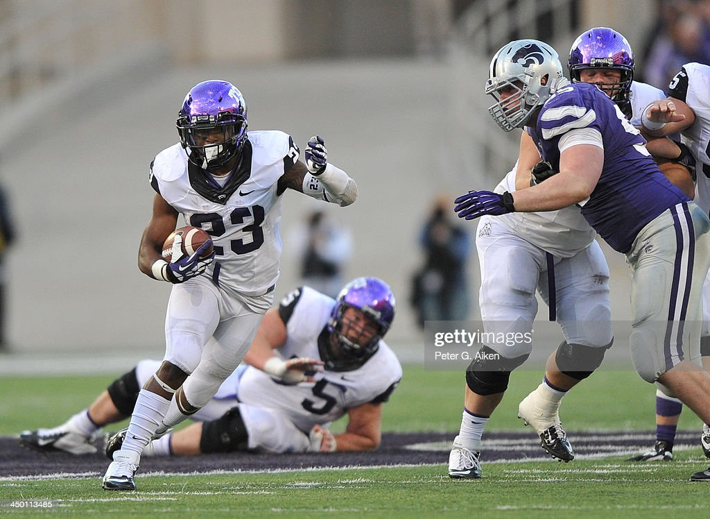 Running back B.J. Catalon #23 of the TCU Horned Frogs rushes up field against the Kansas State Wildcats during the second half on November 16, 2013 at Bill Snyder Family Stadium in Manhattan, Kansas. Kansas State defeated TCU