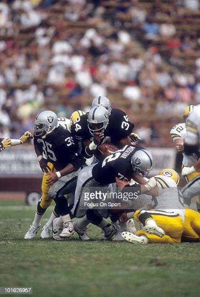 Running back Bo Jackson of the Los Angeles Raiders carries the ball against the Green Bay Packers November 11 1990 during an NFL game at the Los...