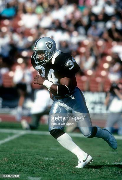 Running back Bo Jackson of the Los Angeles Raiders carries the ball against the Kansas City Chiefs during an NFL football game at the Los Angeles...