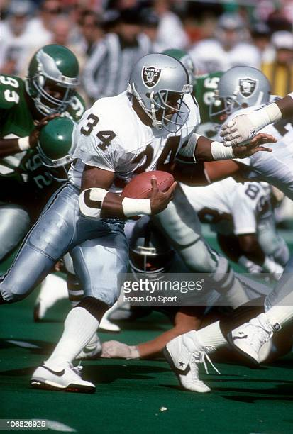 Running back Bo Jackson of the Los Angeles Raiders carries the ball against the Philadelphia Eagles during an NFL football game at Veterans Stadium...