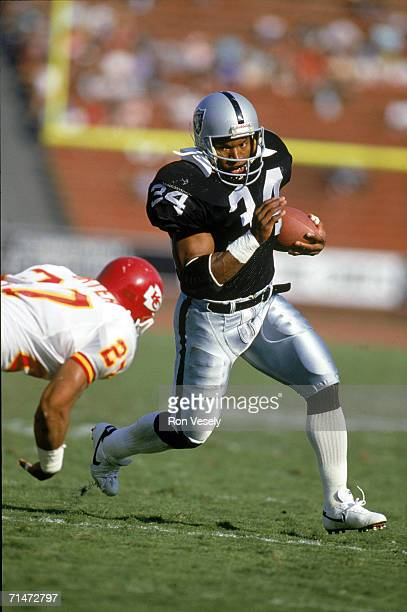 Running back Bo Jackson of the Los Angeles Raiders carries the ball against the Kansas City Chiefs during a game at the Los Angeles Memorial Coliseum...