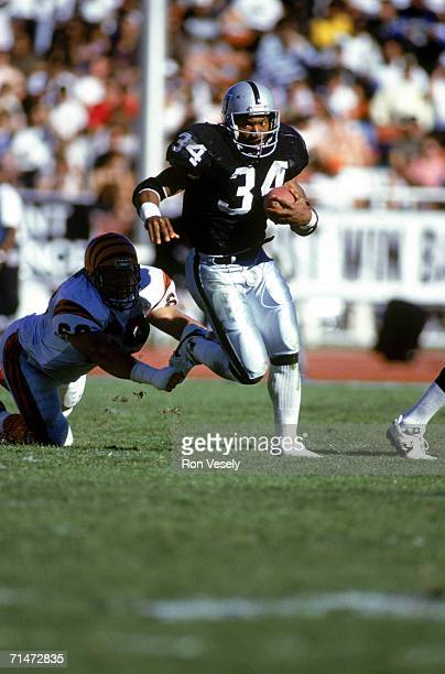 Running back Bo Jackson of the Los Angeles Raiders carries the ball against the Cincinnati Bengals during a game at the Los Angeles Memorial Coliseum...