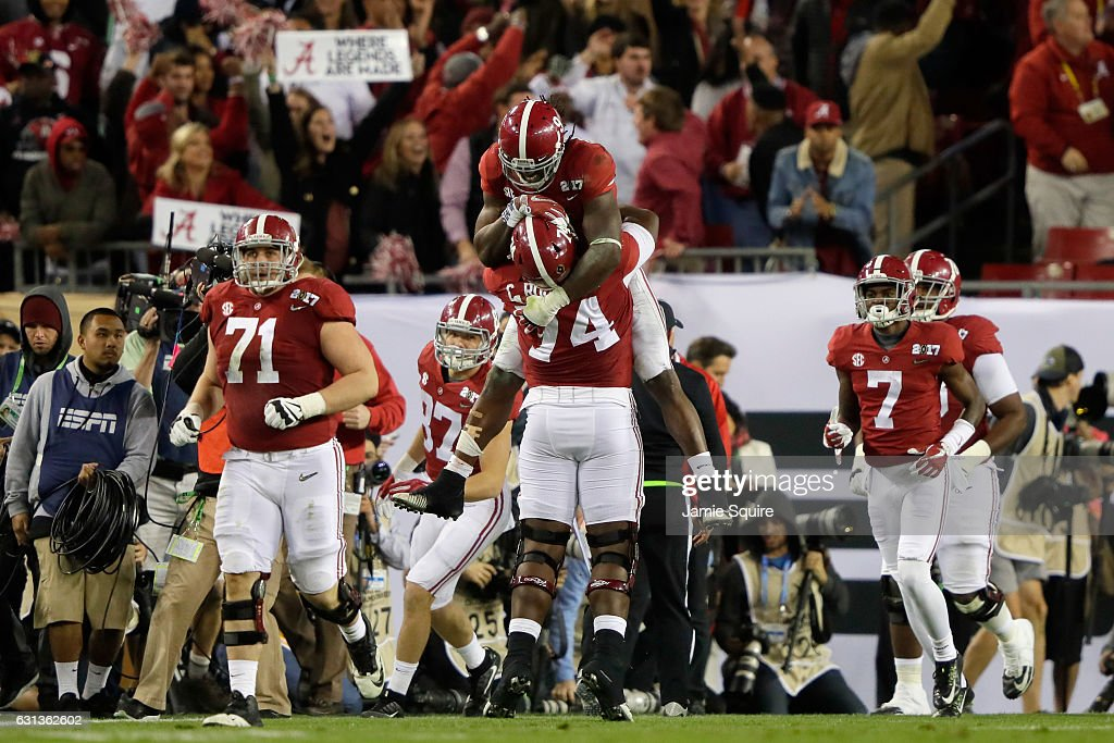 Running back Bo Scarbrough #9 of the Alabama Crimson Tide celebrates with offensive lineman Cam Robinson #74 after rushing for a 37-yard touchdown during the second quarter against the Clemson Tigers in the 2017 College Football Playoff National Championship Game at Raymond James Stadium on January 9, 2017 in Tampa, Florida.