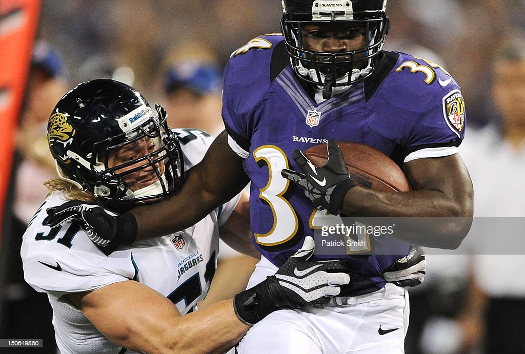 Running back Bobby Rainey #34 of the Baltimore Ravens eludes linebacker <a gi-track='captionPersonalityLinkClicked' href=/galleries/search?phrase=Paul+Posluszny&family=editorial&specificpeople=2089891 ng-click='$event.stopPropagation()'>Paul Posluszny</a> #51 of the Jacksonville Jaguars in the second quarter at M&T Bank Stadium on August 23, 2012 in Baltimore, Maryland.
