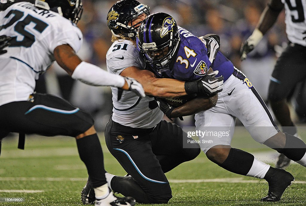 Running back Bobby Rainey #34 of the Baltimore Ravens runs through linebacker <a gi-track='captionPersonalityLinkClicked' href=/galleries/search?phrase=Paul+Posluszny&family=editorial&specificpeople=2089891 ng-click='$event.stopPropagation()'>Paul Posluszny</a> #51 of the Jacksonville Jaguars in the second quarter at M&T Bank Stadium on August 23, 2012 in Baltimore, Maryland.