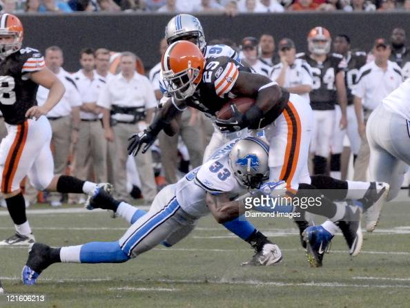 Running back Brandon Jackson of the Cleveland Browns is tackled by cornerback Brandon McDonald of the Detroit Lions during a preseason game on August...