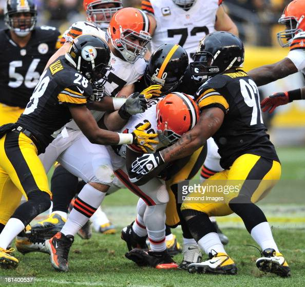 PITTSBURGH PENNSYLVANIA DECEMBER 30 2012 Running back Brandon Jackson of the Cleveland Browns is tackled by linebackers James Harrison Larry Foote...