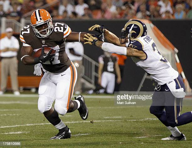 Running back Brandon Jackson of the Cleveland Browns runs by cornerback Corland Finnegan of the St Louis Rams at FirstEnergy Stadium on August 8 2013...