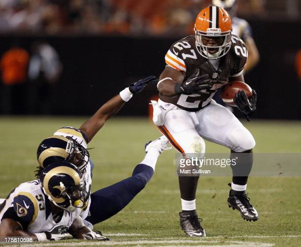 Running back Brandon Jackson of the Cleveland Browns runs by linebacker Daren Bates and cornerback Robert Steeples of the St Louis Rams at...