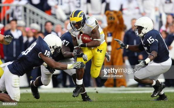 Running back Brandon Minor of the University of Michigan Wolverines runs against Navorro Bowman of the Penn State Nittany Lions at Beaver Stadium on...