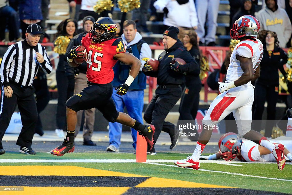 Running back Brandon Ross of the Maryland Terrapins rushes for a first half touchdown against the Rutgers Scarlet Knights at Byrd Stadium on November...