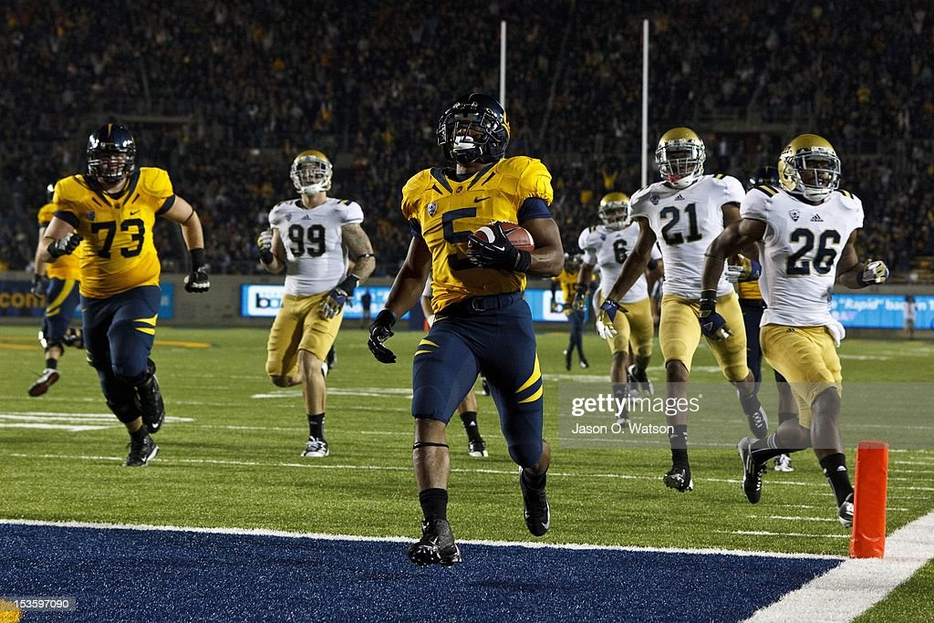 Running back Brendan Bigelow #5 of the California Golden Bears scores a touchdown against the UCLA Bruins during the third quarter at California Memorial Stadium on October 6, 2012 in Berkeley, California. The California Golden Bears defeated the UCLA Bruins 43-17.