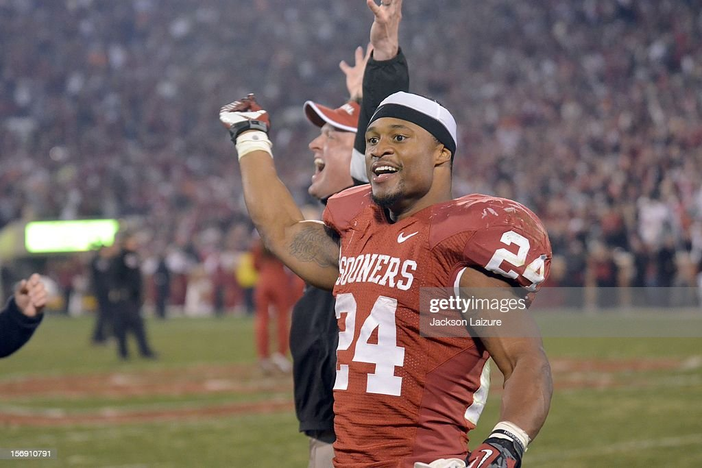 Running back Brennan Clay #24 of the Oklahoma Sooners celebrates after scoring the game winning touchdown in overtime in their game against the Oklahoma State Cowboys on November 24, 2012 at The Gaylord Family Oklahoma Memorial Stadium in Norman, Oklahoma.