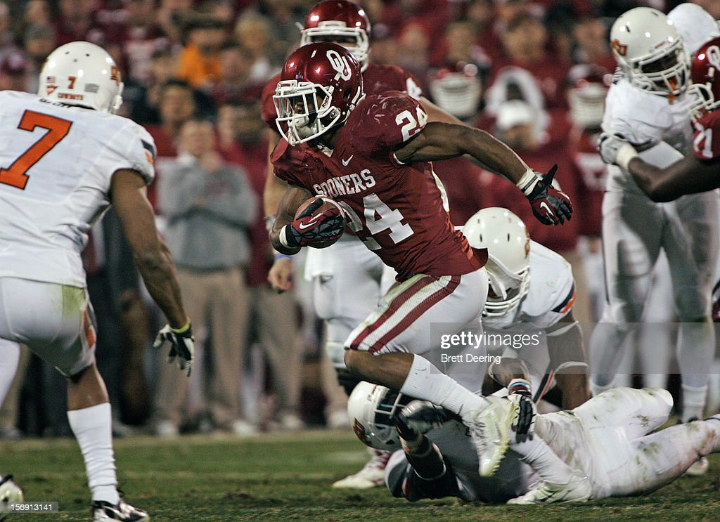 Running back Brennan Clay #24 of the Oklahoma Sooners rushes against the Oklahoma State Cowboys November 24, 2012 at Gaylord Family-Oklahoma Memorial Stadium in Norman, Oklahoma. Oklahoma defeated Oklahoma State 51-48 in overtime.