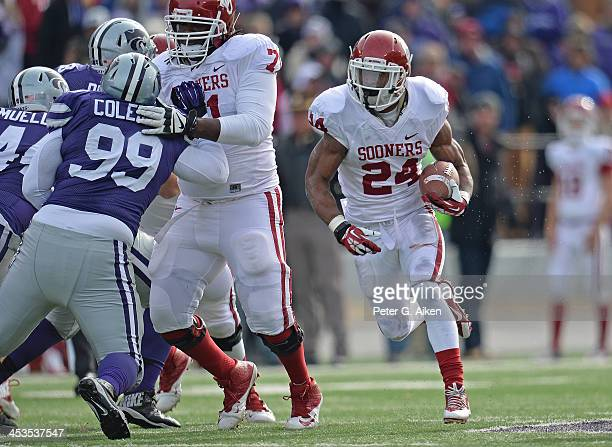Running back Brennan Clay of the Oklahoma Sooners rushes against the Kansas State Wildcats during the first half on November 23 2013 at Bill Snyder...