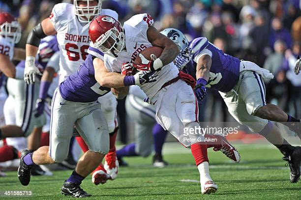 Running back Brennan Clay of the Oklahoma Sooners rushes for a threeyard touchdown through the Kansas State Wildcats defense during the second half...