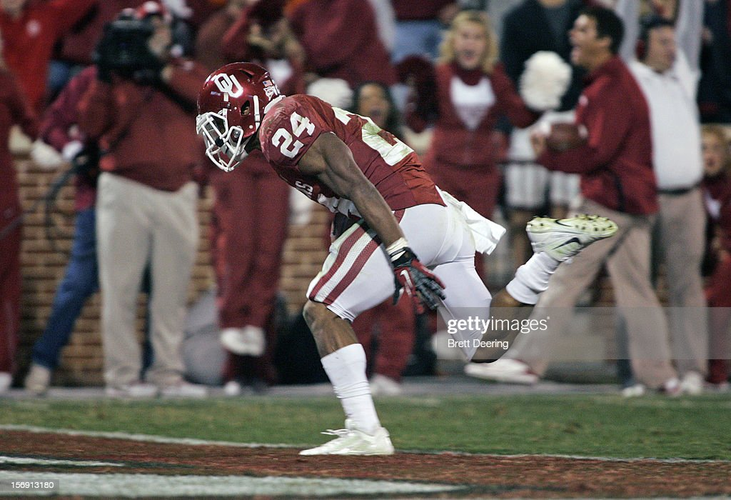 Running back Brennan Clay #24 of the Oklahoma Sooners scores the winning touchdown in overtime against the Oklahoma State Cowboys November 24, 2012 at Gaylord Family-Oklahoma Memorial Stadium in Norman, Oklahoma. Oklahoma defeated Oklahoma State 51-48 in overtime.