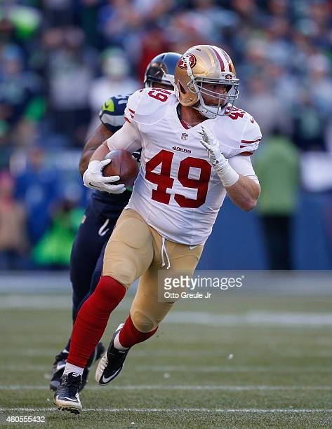 Running back Bruce Miller of the San Francisco 49ers rushes against the Seattle Seahawks at CenturyLink Field on December 14 2014 in Seattle...